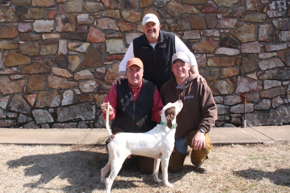 Scout Eddy Taylor and handler Stacy Perkins with 2014 Invitational Champion Not'ta Snow Ball's Chance.  Back:  Owner Rex Garner